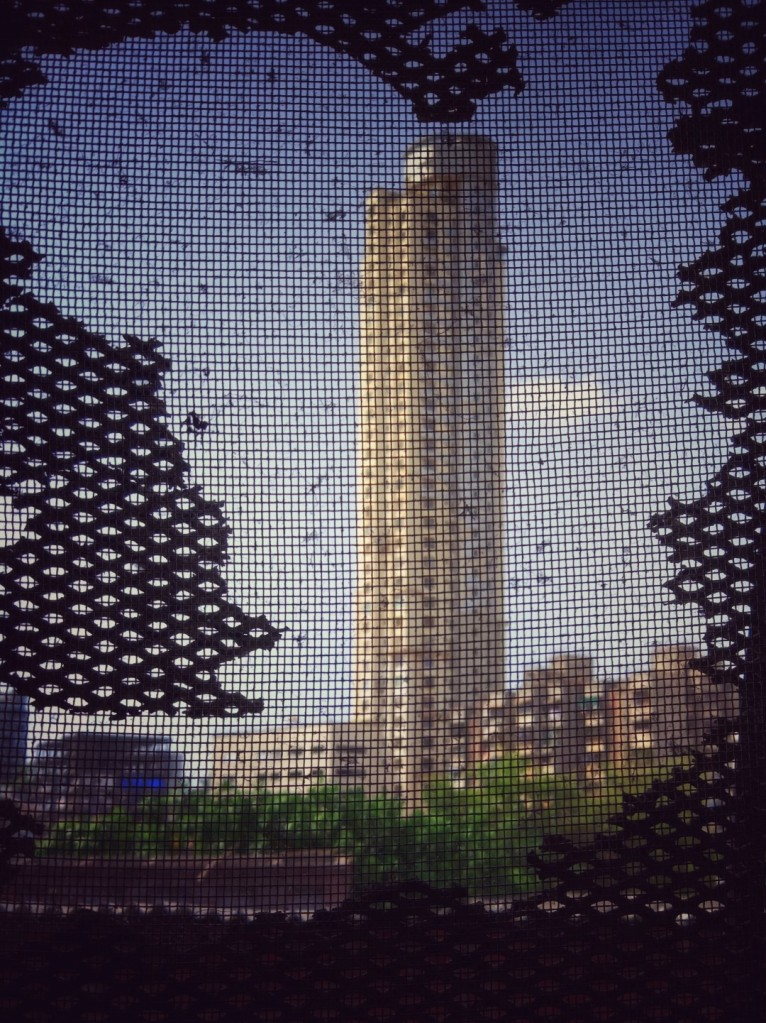 tower through the broken window grille