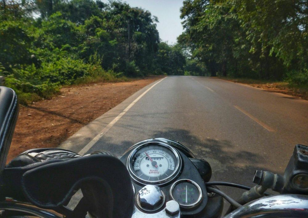 Royal Enfield Cast Iron Electra. A Bullet 350 thumping down the winding roads of South Goa