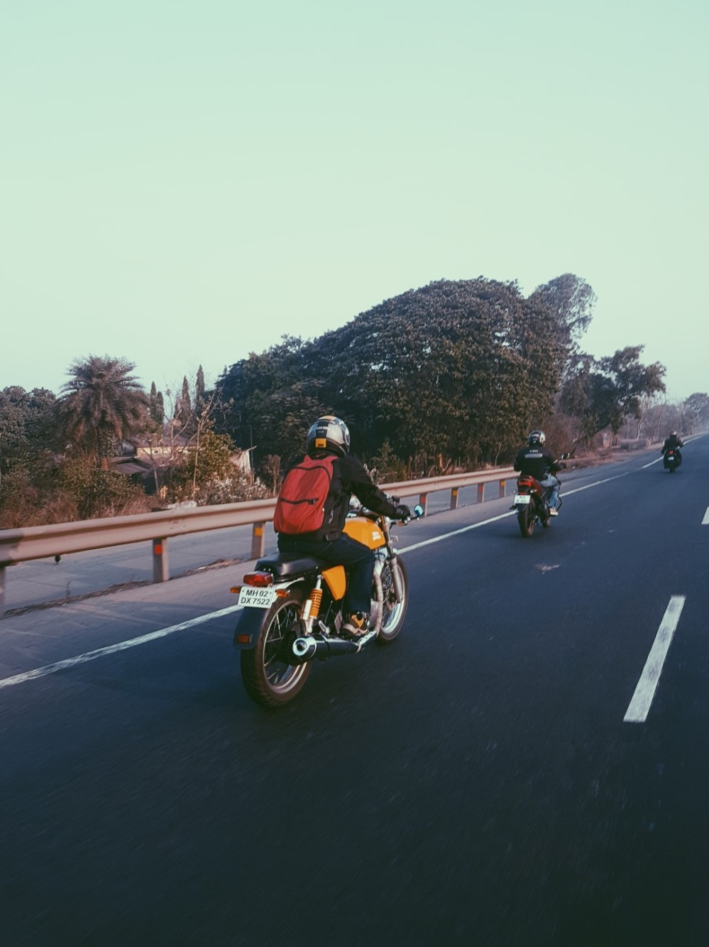 Yellow Royal Enfield Continental GT on the highway